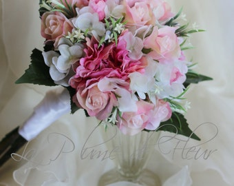 Bride's bouquet, wedding bouquet, romantic pink and white bouquet, white hydreangea, creamy pink roses, pink peonies and white wildflowers.
