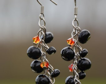 Beautiful earrings with black glass beads and Swarovski fire crystals beads