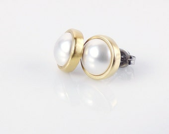 White pearl stud earrings. Gold tone brass studs. Basic everyday earrings.
