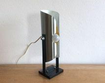 Vintage Sixties Dutch Raak Design modernist chromed table lamp white interior with yellow circle on plexiglass base