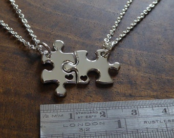 Two Silver Puzzle Charms with Hearts Pendant Necklaces