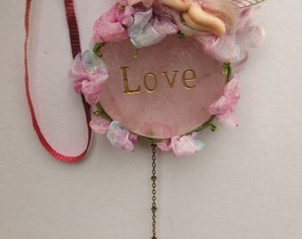 sweet tiny ooak fairy fairie on rose quartz   crystal with swarovski suncatcher crystal heart