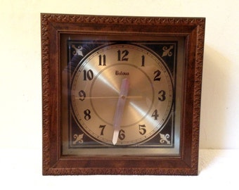 vintage bulova wood cased clock wall or shelf quartz battery operated gold face