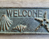 Cast Iron Sea Shell Welcome Sign
