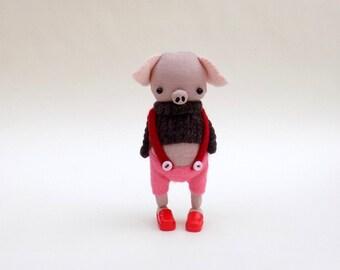 Pink Muslin Pig  -  Handmade plush pig wearing pink felt pants, brown woollen pullover and red plastic mules.