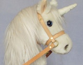 Childs Hobby horse unicorn (stick horse). Top quality plush fur fabric with hardwood pole wheels and removable leather bridle with bell.
