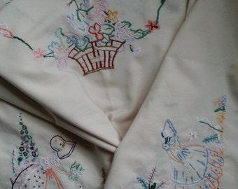 Rectangular embroidered crinoline lady, vintage tablecloth.