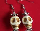 Skull with crown earrings