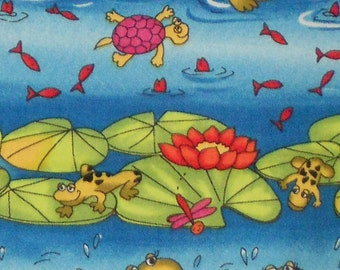 One yard of cotton fabric with blue background and dancing frogs