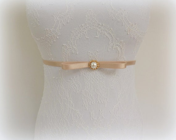 Champagne bow belt. Thin elastic waist belt with gold plated button and ivory pearl. Bridal/ Bridesmaid dress belt.