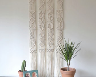 Macrame wall hanging with natural cotton twine on a reclaimed tree branch. 70s, minimal, ecological, modern, vintage, geometrical, boho
