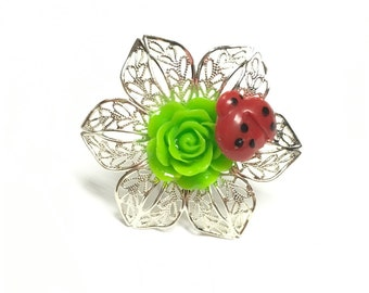 Filigree leaf and flower ring, green flower with ladybug ring