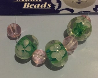 Blue Moon Glass Beads - Purple and Green w/ White Flower Design 7 pcs