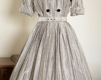 Grey/Silver 1950s dress with black flocking and matching belt
