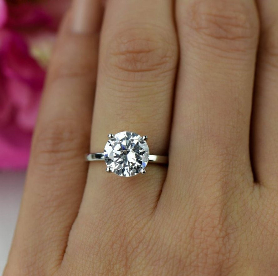 Wedding band that goes around engagement ring