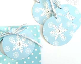 Snowflake gift tags in blue and white. Christmas, Xmas gift wrapping, birthday party favor tags. Hand punched. Snow queen princess party.