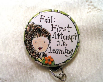 For the teacher or coach--Learn from your mistakes sentiment on this retractable id badge holder with attached charm