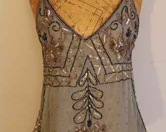 1990s beaded sequinned vest in a sage green, size small