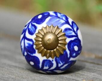 Ceramic knob/cabinet/door handle/white/blue/round/flower/floral/petite/small/drawer pull/decorative/furniture/hardware/dresser/kitchen