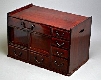 Red Lacquer Japanese Ko Tansu. Meiji Era. Seven Drawer Two Door Hikidashi