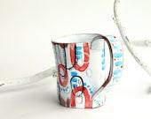 ceramic coffee mug, colorful red light blue artistic cup