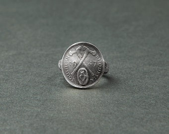 Ring Piece of currency / Warrior / British corner (ring and silver coin) / two axes cross