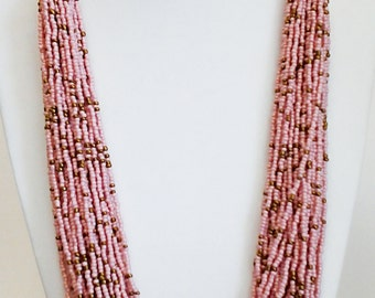 Pink and Copper Multi Strand Beaded Adjustable Suede Braid Necklace.
