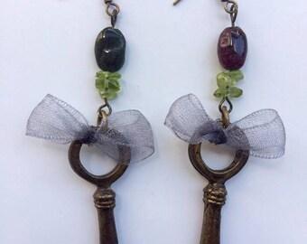 Low Key earrings, tourmalines and peridot in vintage brass keys.