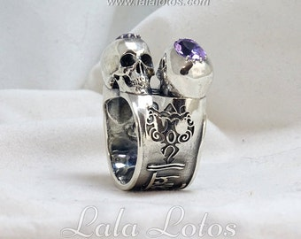 Om Namah Shivaya nielloed silver ring featuring mantra, a couple of amethysts and a couple of skulls.