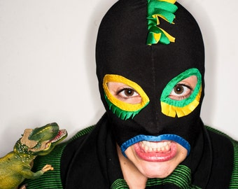 Funky black wrestling mask with colorful fringe details under eyes and top of the head crest.