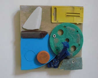 Sailboat. Artworks made of waste, plastic soup washed ashore. Wooden panel, size 15 x 15 cm.
