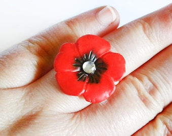 Adjustable ring with polymer clay poppy and glitter