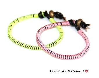 The Lot(Prize) of two fluorescent pink and yellow leather bracelets Wrap