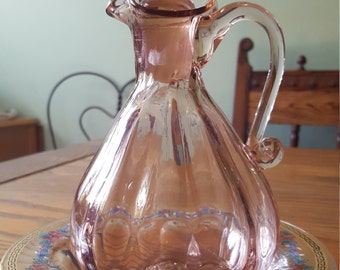 PInk glass, pitcher and bowl set.  Vintage, hand blown.