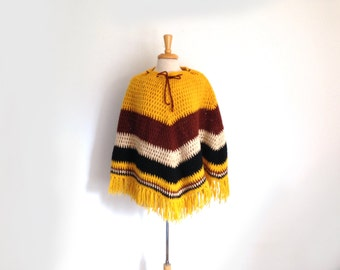 1960s or 1970s knit wool  poncho in mustard yellow and brown
