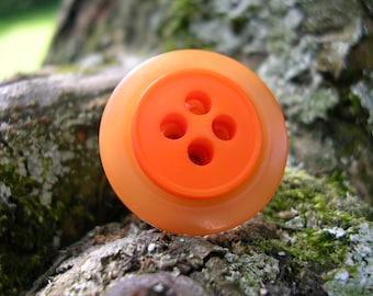 Orange button ring.
