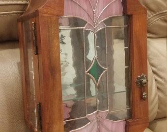 Vintage 80's hardwood wall cabinet / mirrored inside and stained glass artwork in it's door.