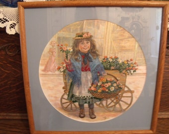 "A Victorian Girl Peddling Basket of Flowers Vintage Hand Embroidered and Framed Art Glass Front  17"" x 17"" 1988"