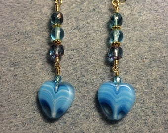 Turquoise Czech glass heart bead dangle earrings adorned with turquoise Czech glass beads.