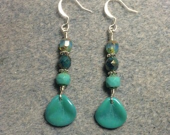 Opaque turquoise rose petal dangle earrings adorned with turquoise Czech glass beads.