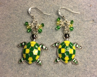 Green and yellow enamel turtle charm earrings adorned with tiny green and yellow Czech glass and Chinese crystal beads.
