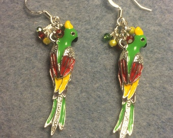 Green, red, and yellow enamel parrot charm dangle earrings adorned with tiny dangling green, red and yellow Chinese crystal beads.