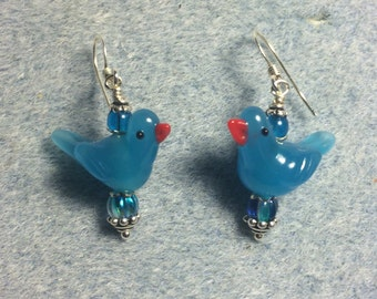 Turquoise lampwork songbird dangle earrings adorned with turquoise Czech glass beads.