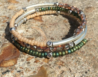 Faceted crystal, Silver tube and seed bead memory wire bracelet