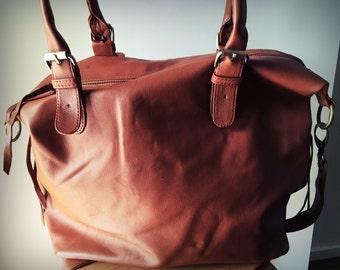 Real leather shoulder tote bag,crossbody bag.Overnight bag,computer bag. Lots of room, side pockets. Real leather shoulder tote bag