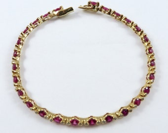 Beautiful 7 inch 18K Yellow Gold Round Diamond and Ruby Tennis Bracelet