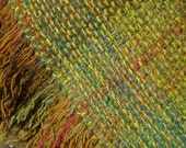 Saddle cloth: cool, naturally wicking, handwoven in British wool in Devon hedgerow greens