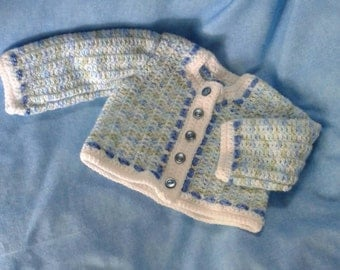 Crochet baby boy sweater.  Button up cardigan sweater. Long sleeves. Shades of blue. Sizes preemie to 12 months. Baby Shower Gift.