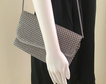 Asymmetrical 80's matt grey glowmesh bag with snake chain strap