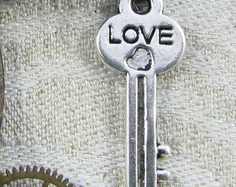 Set of (12) The Key to Love Charms, 12 per package LOV005